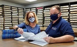 Register of Deeds Craig Olive (right) and vital records supervisor Amy Zieverink, (left) review out-of-county marriage applications and out-of-county birth requests.