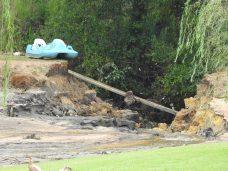 An earthen dam is washed away near Four Oaks