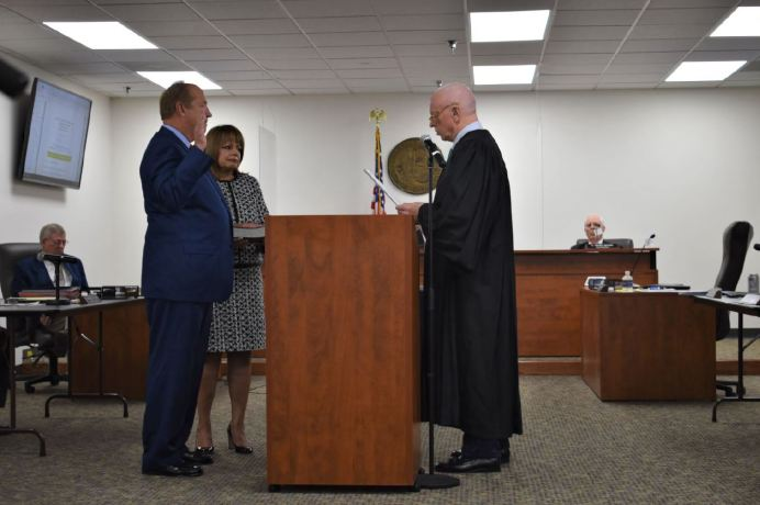 Honorable Franklin F. Lanier, Retired Superior Court Judge, administered the oath of office in the County Administration Building in Lillington and Matthews' wife, Rosa Marie Matthews, held the Bible during the ceremony.