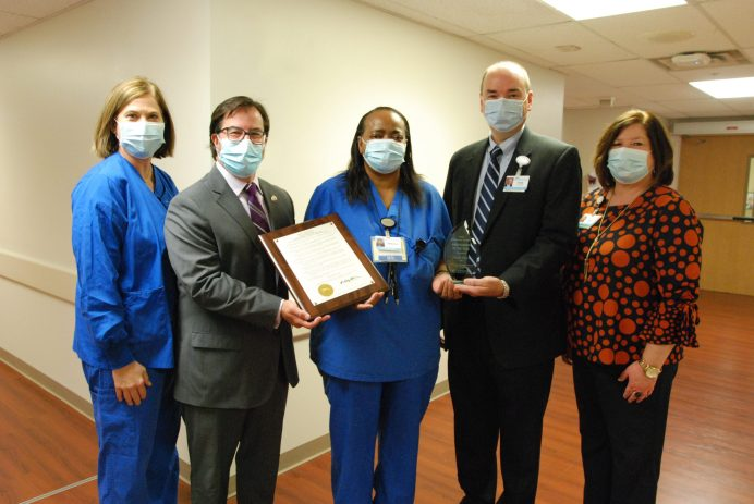 Sheila Nixon, RN, at center, has been named Johnston Health Ambassador of the Year. From left, are: Karla Allen, manager of OR operations; Andy Moore, mayor of the Town of Smithfield; Sheila Nixon, Ambassador of the Year; Tom Williams, CEO and president; and Amy Hamby, associate vice president of patient care services.