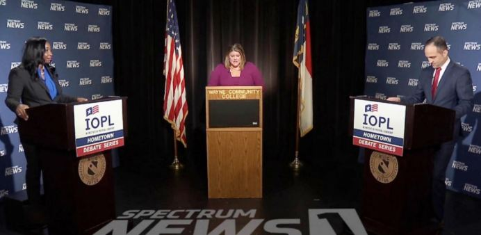 Democrat Jessica Holmes, at left, and Republican Josh Dobson, right, debate in the Hometown Debate series in the race for N.C. Commissioner of Labor. At center is Spectrum News anchor and moderator Loretta Boniti. Screenshot from Spectrum News