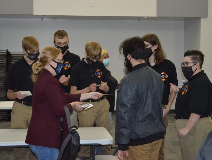 Chelsea Partridge, a test engineer for the Orion Capsule and president of the Missile, Space and Range Pioneers, presented Orion patch stickers to members of the f(x) First in Orbit team after their presentation on Oct. 24, 2020. Photo by Dunja Nascimento-Wilson
