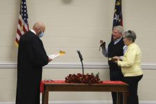 Kay Carroll is sworn in by Superior Court Judge Tom Lock. JCPS Photo