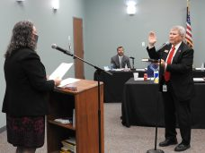 Commissioner Ted Godwin of Selma takes his oath of office from Clerk of Court Michelle Ball.
