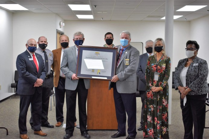 Sheriff Wayne Coats presents the National Accreditation certificate from the Commission on Accreditation for Law Enforcement Agencies, Inc. (CALEA) to the Harnett County Board of Commissioners at the January 4, 2021 meeting