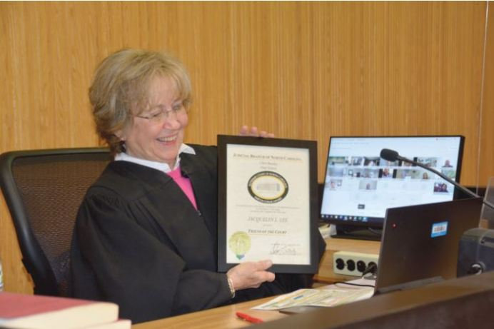 District Court Judge Jacquelyn Lee receives her 'Friend of the Court Award' as Chief Justice Cheri Beasley virtually congratulates her. Dunn Daily Record Photo