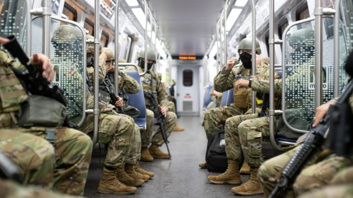 U.S. Soldiers with the North Carolina National Guard ride a metro train in Washington, D.C., Jan. 20, 2021. U.S. Army National Guard photo by Sgt. Abraham Morlu