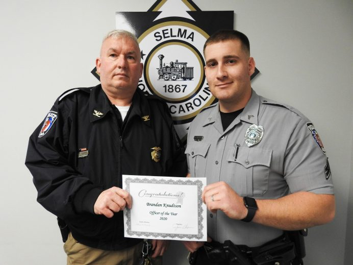 (Left to right) Selma Police Chief W.M. Thomas presents the 2020 Officer of the Year Award to Corporal Brandon Knudtson. JoCoReport.com Photo