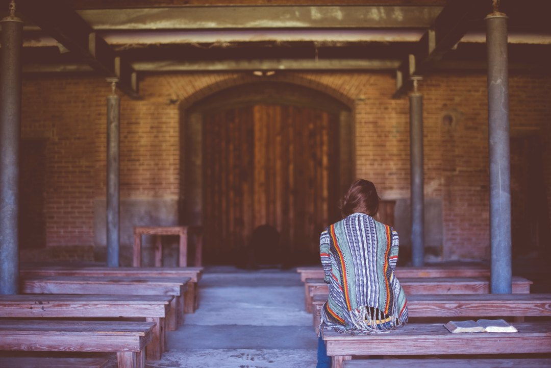 Woman on bench at chapel