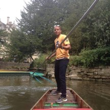 Steering a punt around Oxford (pinkies up!)