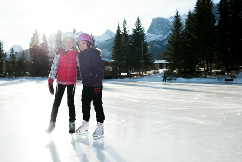 two girls on outdoor ice rink