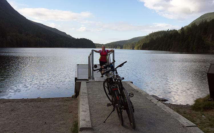Cycling near Buntzen Lake, British Columbia, Canada. Here are our bikes parked at North Beach. And Maggie too!