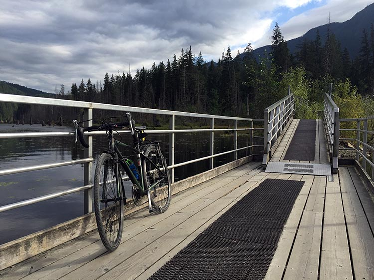 Biking and Hiking Near the Anmore RV Park in the Buntzen Lake Area, British Columbia. My bike on the floating bridge over Buntzen Lake, on the pedestrian trail to Buntzen Lake
