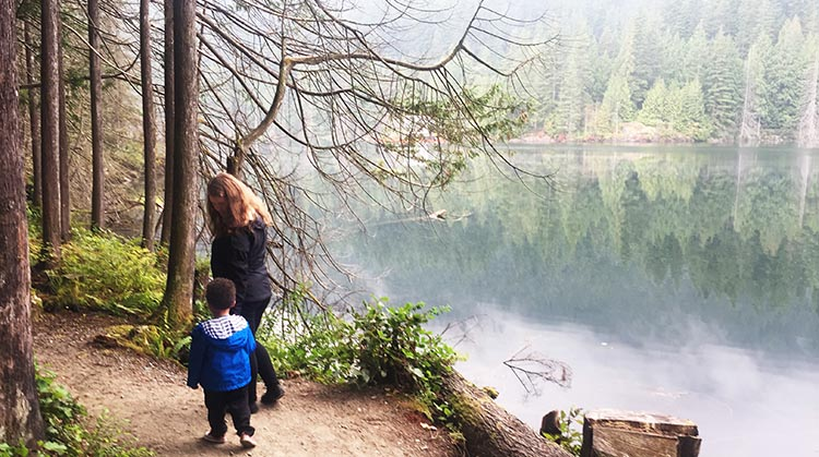 Celena and Hunter next to Buntzen Lake, on the Energy Trail