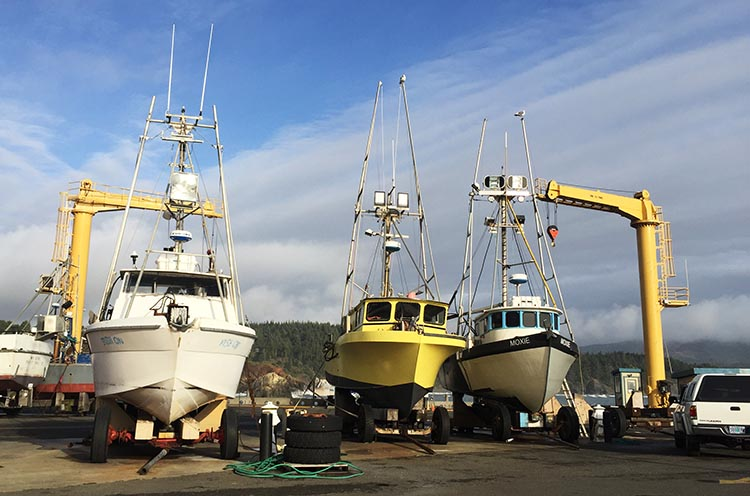 Our Experience of RV Camping at Beverly Beach and Humbug Mountain State Parks, Oregon Coast. The only way boats enter or leave the port of Port Orford is by being hoisted down or up by one of the two giant hoists