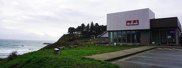 Our Experience of RV Camping at Beverley Beach and Humbug Mountain State Parks, Oregon Coast. Redfish restaurant looks out over the stormy wind-swept ocean.
