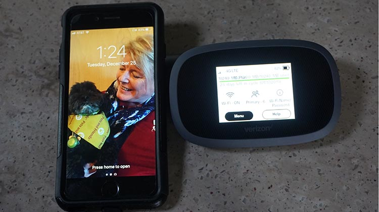 On the right is our new Verizon Jetpack. I put my iPhone in to show how small it is. As you can see, it is a very small device - but it's a mighty mouse!