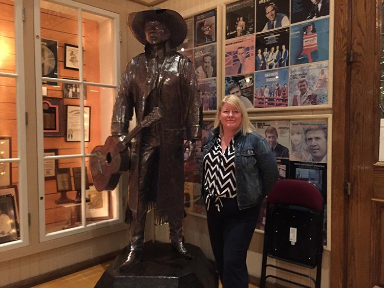 RV Camping in California. Maggie withe the life-sized statue of Buck Owens at Buck Owens' Crystal Palace in Bakersfield