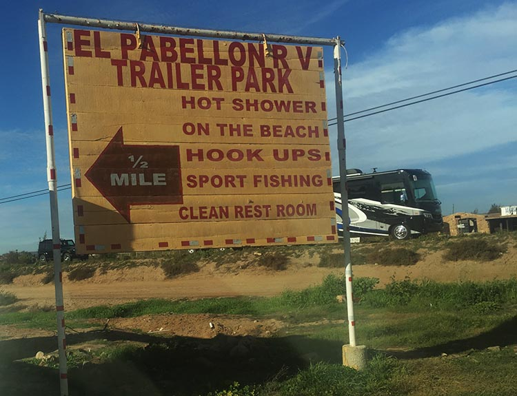 Another sign post for El Pabbelon RV Park lets you know what it has to offer