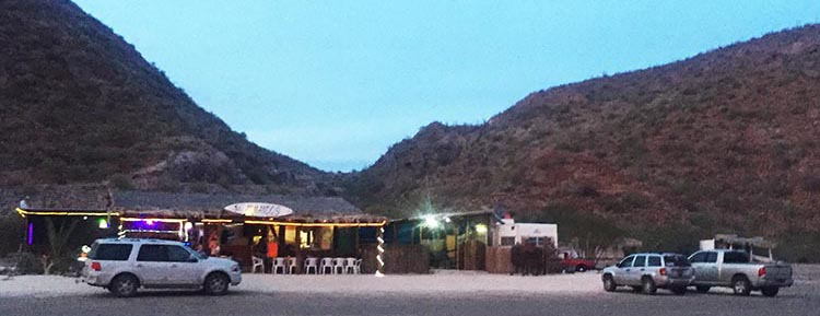 This photo shows the constantly popular Armando's Restaurant on Santispac Beach, in the early evening