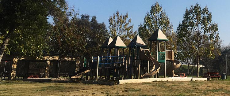 Review of Merced River RV Resort, Delhi, California. There is a children's playground at the Merced River RV Resort.