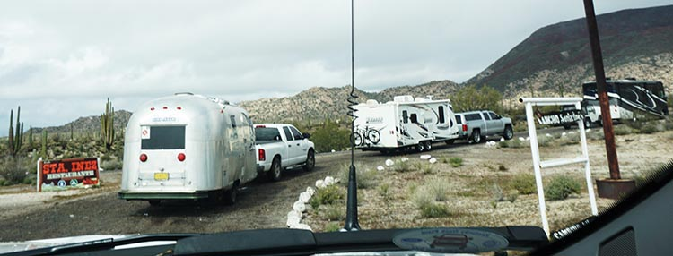 Our caravan of RVs heading down the dirt road to Rancho Santa Inez