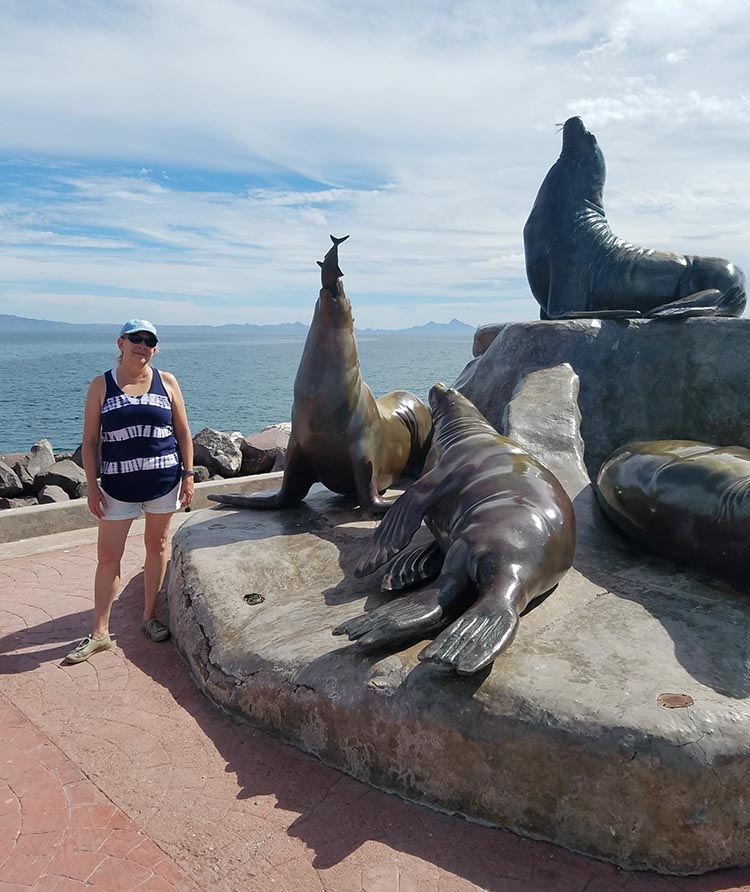 Juli next to a sea lions statue in Loreto - Photo supplied by Juli Cooley