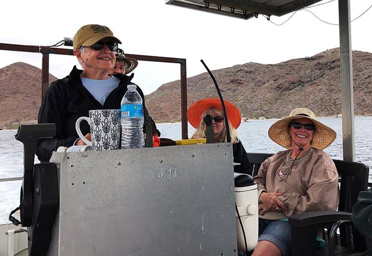 Here's Myrna taking a turn to pilot the boat. Photo courtesy of Myrna Spaulding