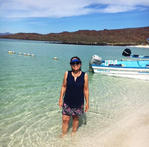 Nancy enjoying the azure waters of Loreto - Photo by Richard Bacciarini