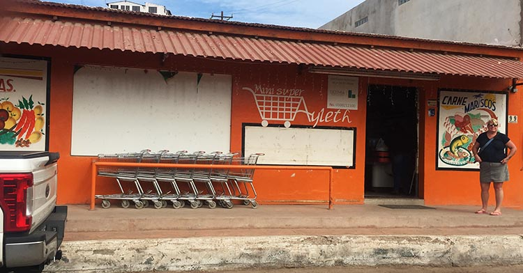 Here's Maggie outside the best grocery store in Mulege. It is behind the tiny fire station
