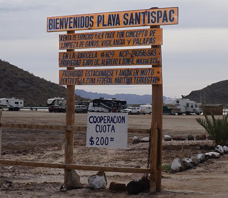 Dry RV Camping on Santispac Beach, Bahia Concepcion, Baja California Sur, Mexico. Here is the sign outside Santispac Beach. The daily fee is 200 pesos, which is a great deal