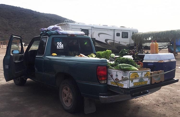 Dry RV Camping on Santispac Beach, Bahia Concepcion, Baja California Sur, Mexico. The fresh vegetables and fruit truck on Santispac Beach
