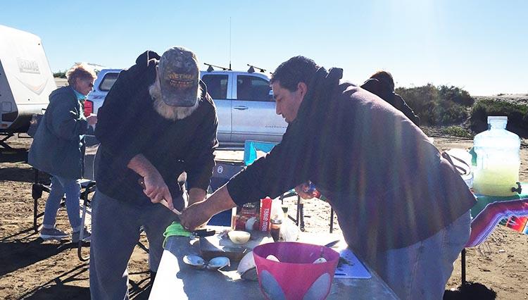 Joe was recruited to help Jose prepare the clams
