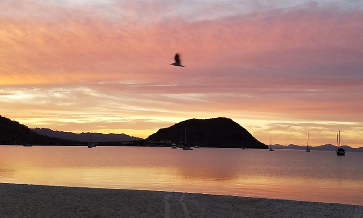The view of Santispac beach was even more spectacular at sunrise. Photo by fellow traveler Juli Cooley