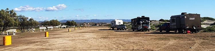 Our Return RV Caravan Trip from Baja California: Santispac Beach to Tecate. Some of the rigs belonging to the rest of the group. As you can see, El Pabellon RV Park is pretty much just a huge patch of dirt, next to the sea. A few of the sites have hook-ups