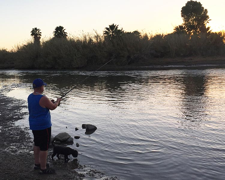 Joe enjoyed some fishing on the Colorado River, inside the Arizona Oasis RV Resort