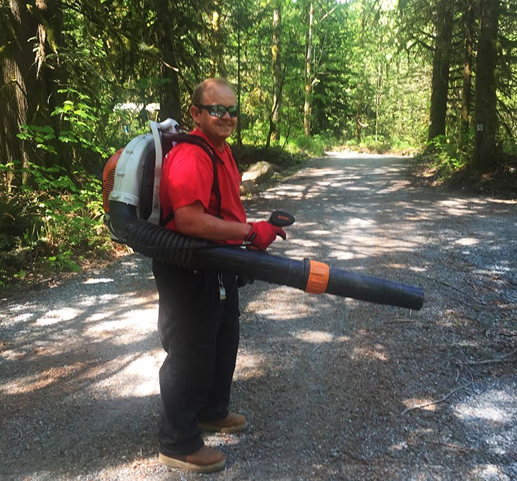Workamping at Paradise Valley Campground, Squamish, BC, Canada. Using the leaf blower was tiring at first, but it soon became my favorite task!