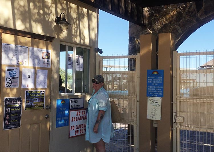 Here's Maggie at the security gate to the wonderful pool complex, which we visit every day