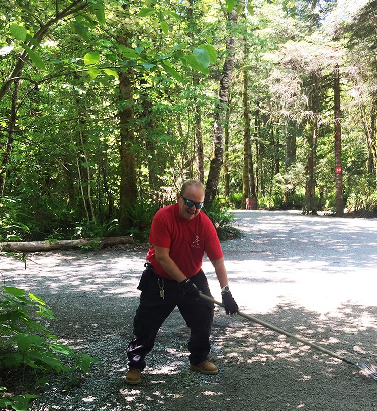 How to Become a Workamper – a Complete Guide to Work Camping. Male workampers can usually expect to be physically active all day long. Here's Joe, raking gravel!