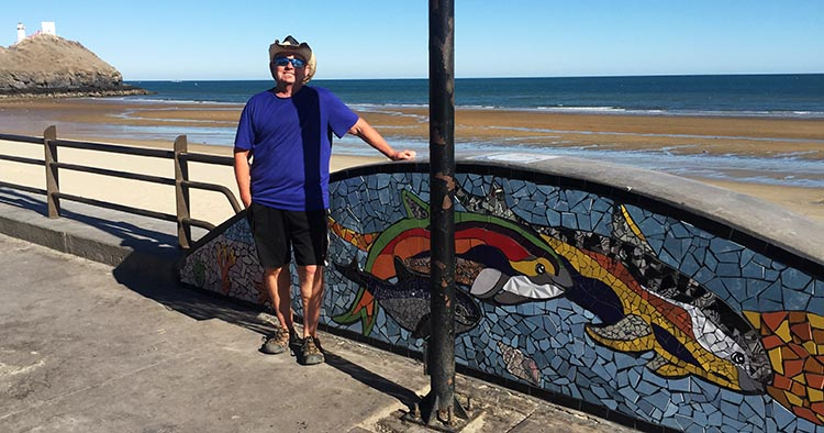Here is Joe posing next to one of the mosaics. In the background is the lighthouse