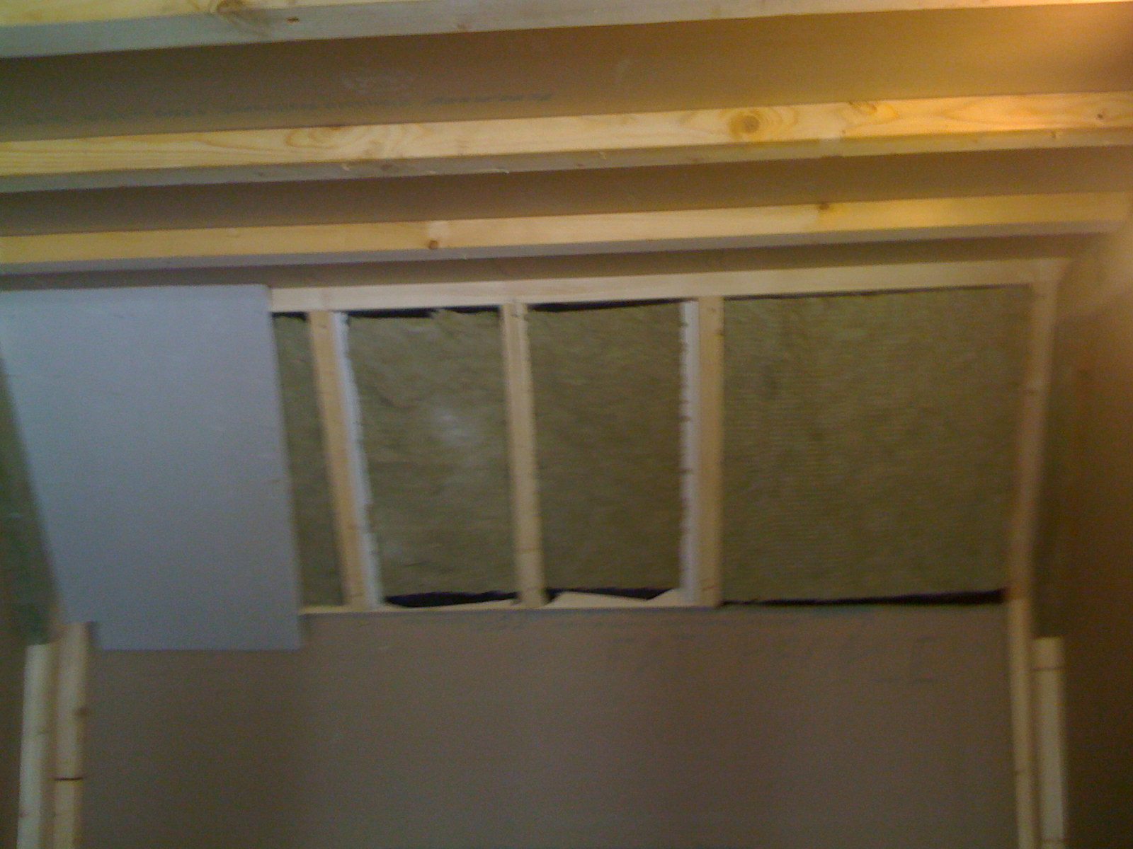 Now, a layer of plasterboard in front of the rockwool. There's be some more SterlingOSB added onto this, so we can screw in the timbers for the final rockwool/hessian layer.