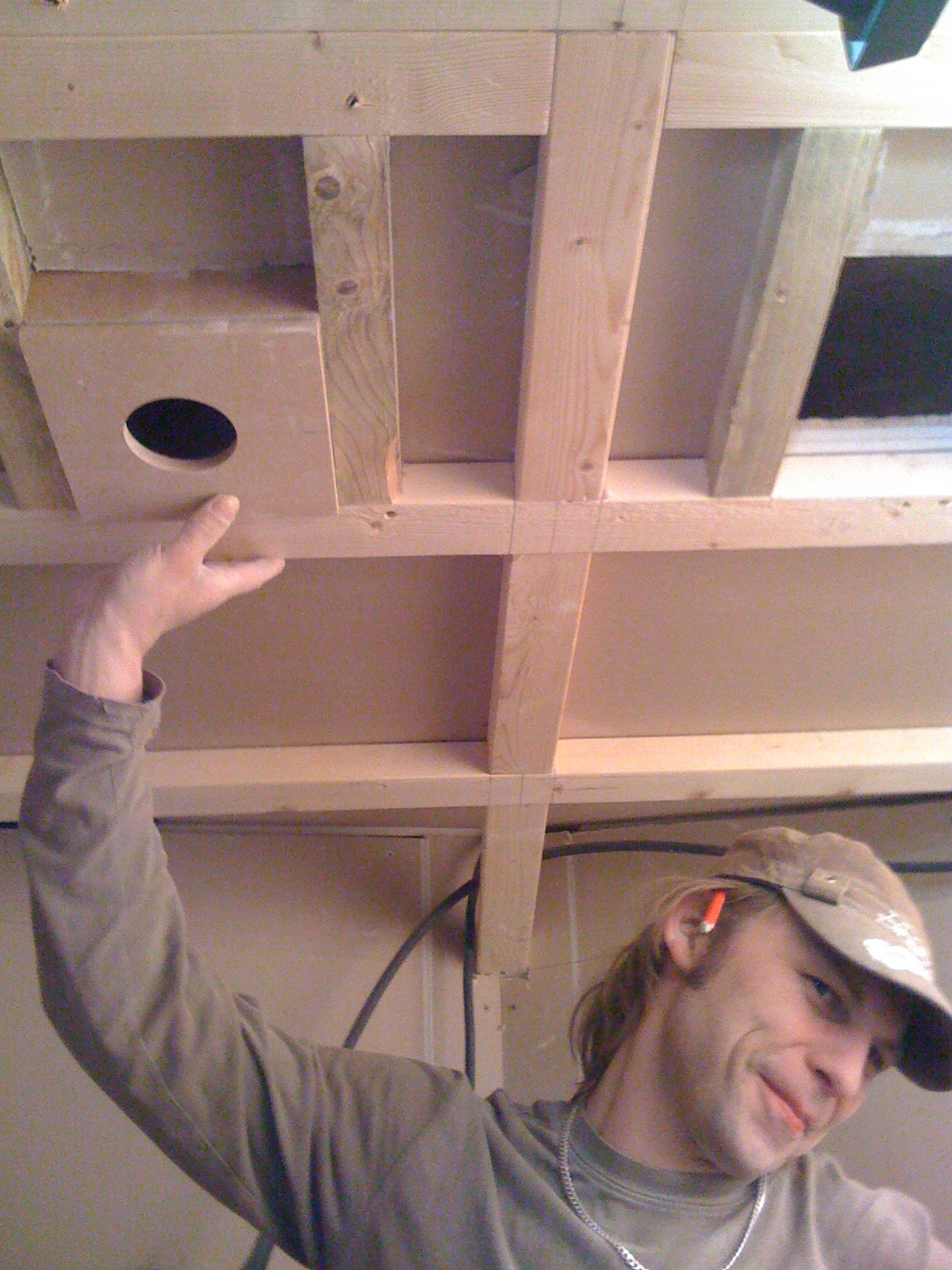 Here's how the lighting panel will fit into the ceiling. Artis tries valiantly to get out of shot but realises at the last minute that his arms aren't long enough...