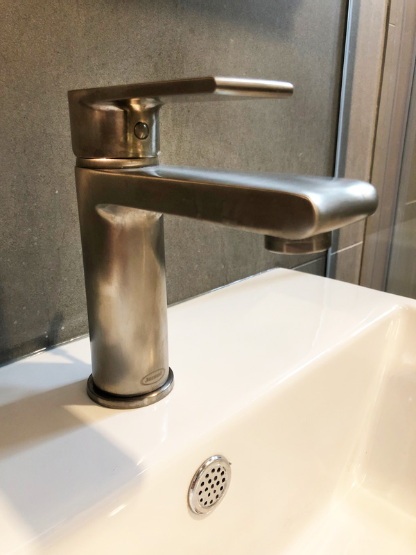 Interior Design New York Joe Cangelosi NYC Sexy Masculine Bathroom Faucet