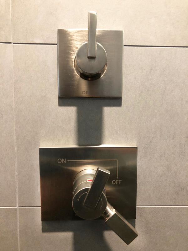 Interior Design New York Joe Cangelosi NYC Sexy Masculine Bathroom Shower Controls