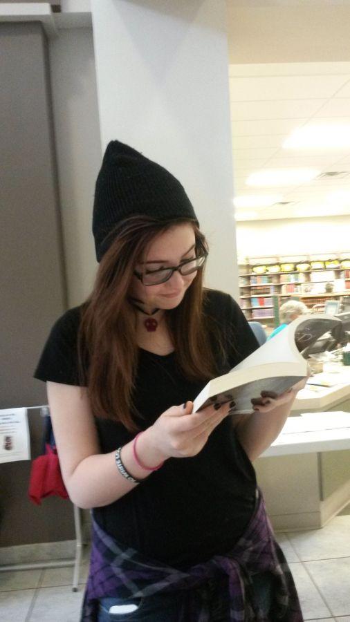 Mackenzie Reedybacon reading Memories of a Ghost.