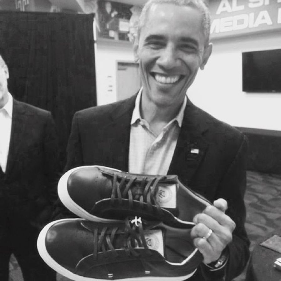 Obama with his gift of a custom-made pair of GREATS