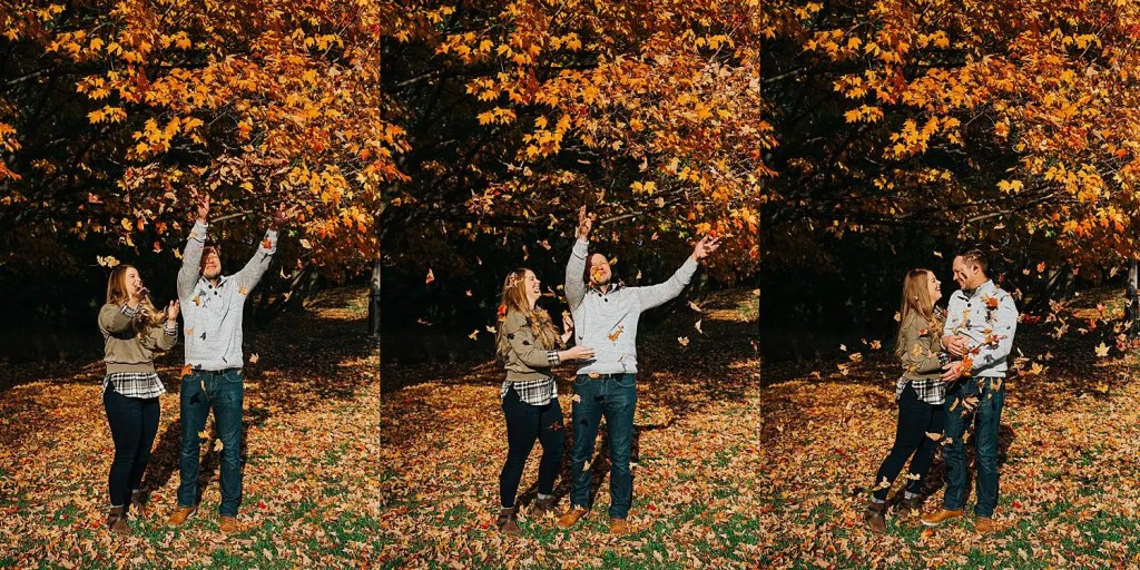 Couple throwing fall leaves for their engagement photos at the Guelph Arboretum