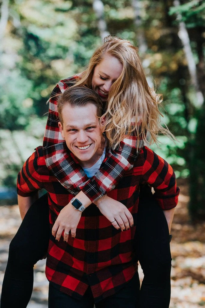 couple doing a piggyback during engagement photos in Toronto