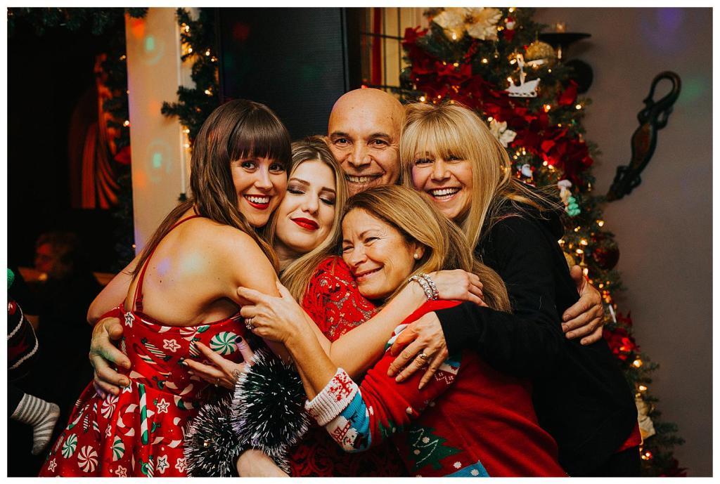 Bride hugging family at a wedding
