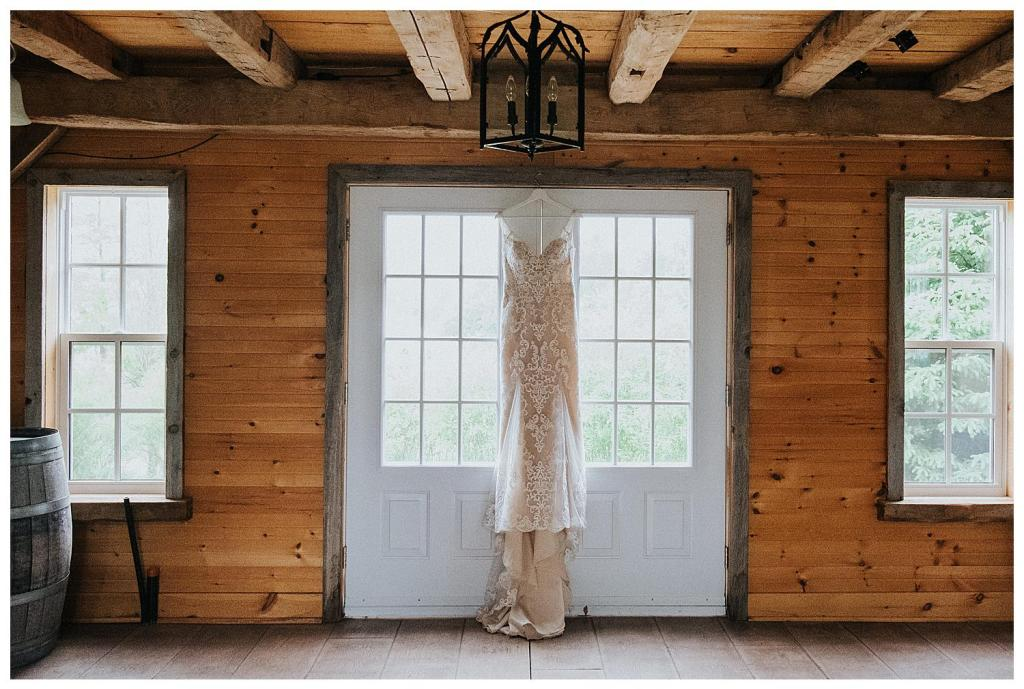 Wedding dress hanging in the barn | The Special Events Centre